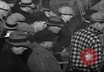Image of sullen crowd views Canadian fishing boat Boston Massachusetts USA, 1935, second 5 stock footage video 65675046899