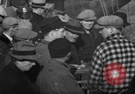 Image of sullen crowd views Canadian fishing boat Boston Massachusetts USA, 1935, second 10 stock footage video 65675046899