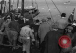 Image of crowd watches Canadian boat Boston Massachusetts USA, 1935, second 4 stock footage video 65675046901