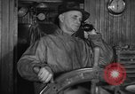 Image of Fishing boat Captain reports catch on radio Boston Massachusetts USA, 1935, second 3 stock footage video 65675046907