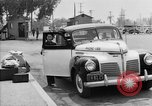 Image of Japanese internee arrives by taxi Santa Anita California USA, 1942, second 6 stock footage video 65675046926