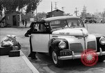 Image of Japanese internee arrives by taxi Santa Anita California USA, 1942, second 8 stock footage video 65675046926
