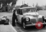 Image of Japanese internee arrives by taxi Santa Anita California USA, 1942, second 9 stock footage video 65675046926