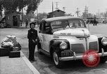 Image of Japanese internee arrives by taxi Santa Anita California USA, 1942, second 10 stock footage video 65675046926