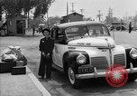Image of Japanese internee arrives by taxi Santa Anita California USA, 1942, second 11 stock footage video 65675046926
