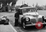 Image of Japanese internee arrives by taxi Santa Anita California USA, 1942, second 12 stock footage video 65675046926
