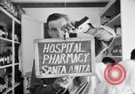 Image of Japanese internment center hospital pharmacy Santa Anita California USA, 1942, second 3 stock footage video 65675046932