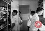 Image of Japanese internment center hospital pharmacy Santa Anita California USA, 1942, second 4 stock footage video 65675046932