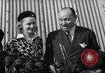 Image of Sir Hubert and Lady Wilkins speaking on arrival aboard the Hindenburg Lakehurst New Jersey USA, 1936, second 10 stock footage video 65675047077