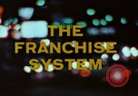 Image of franchise system United States USA, 1974, second 7 stock footage video 65675047267