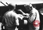Image of Improvised napalm bombs on P-47 aircraft Aslito Airfield Saipan Mariana Islands, 1944, second 8 stock footage video 65675047545