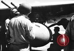 Image of Improvised napalm bombs on P-47 aircraft Aslito Airfield Saipan Mariana Islands, 1944, second 11 stock footage video 65675047545