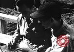 Image of Pilots of 318th Fighter Group debriefed after mission Saipan Mariana Islands, 1944, second 12 stock footage video 65675047554