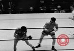 Image of boxer Vince Shomo New York City USA, 1957, second 9 stock footage video 65675047763