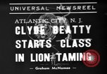 Image of animal tamer Clyde Beatty Atlantic City New Jersey USA, 1939, second 1 stock footage video 65675047782