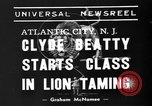 Image of animal tamer Clyde Beatty Atlantic City New Jersey USA, 1939, second 2 stock footage video 65675047782