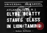 Image of animal tamer Clyde Beatty Atlantic City New Jersey USA, 1939, second 3 stock footage video 65675047782