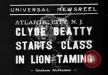 Image of animal tamer Clyde Beatty Atlantic City New Jersey USA, 1939, second 4 stock footage video 65675047782