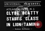 Image of animal tamer Clyde Beatty Atlantic City New Jersey USA, 1939, second 5 stock footage video 65675047782