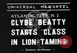 Image of animal tamer Clyde Beatty Atlantic City New Jersey USA, 1939, second 6 stock footage video 65675047782