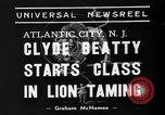 Image of animal tamer Clyde Beatty Atlantic City New Jersey USA, 1939, second 7 stock footage video 65675047782