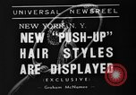 Image of display of hairstyles New York United States USA, 1938, second 4 stock footage video 65675047798