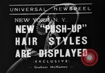 Image of display of hairstyles New York United States USA, 1938, second 5 stock footage video 65675047798