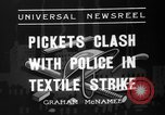 Image of picketing during a textile strike United States USA, 1936, second 4 stock footage video 65675047807