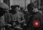Image of bread being distributed to workers Barcelona Spain, 1942, second 8 stock footage video 65675048275