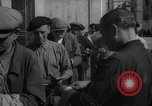 Image of bread being distributed to workers Barcelona Spain, 1942, second 9 stock footage video 65675048275