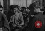 Image of bread being distributed to workers Barcelona Spain, 1942, second 10 stock footage video 65675048275