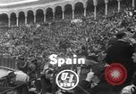 Image of bull fighting Seville Spain, 1950, second 1 stock footage video 65675048291