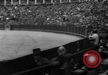 Image of bull fighting Seville Spain, 1950, second 4 stock footage video 65675048291