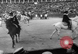 Image of bull fighting Seville Spain, 1950, second 10 stock footage video 65675048291