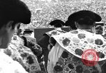 Image of bull fighting Spain, 1956, second 1 stock footage video 65675048297