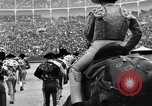 Image of bull fighting Spain, 1956, second 12 stock footage video 65675048297