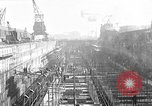 Image of concrete barges Portsmouth England, 1944, second 1 stock footage video 65675048314