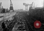 Image of concrete barges Portsmouth England, 1944, second 4 stock footage video 65675048314