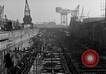 Image of concrete barges Portsmouth England, 1944, second 5 stock footage video 65675048314