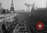 Image of concrete barges Portsmouth England, 1944, second 7 stock footage video 65675048314