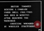 Image of British soldiers carry wounded comrades France, 1916, second 3 stock footage video 65675048369