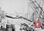 Image of War supplies being unloaded from a freighter Bordeaux France, 1918, second 2 stock footage video 65675048371
