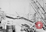 Image of War supplies being unloaded from a freighter Bordeaux France, 1918, second 3 stock footage video 65675048371