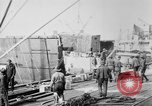 Image of Allied military equipment unloaded from the Arakan Bordeaux France, 1918, second 1 stock footage video 65675048399