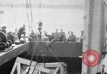 Image of a crane unloading military equipment Bordeaux France, 1918, second 1 stock footage video 65675048400