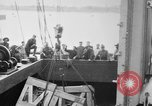 Image of a crane unloading military equipment Bordeaux France, 1918, second 2 stock footage video 65675048400
