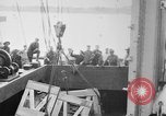 Image of a crane unloading military equipment Bordeaux France, 1918, second 3 stock footage video 65675048400
