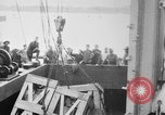 Image of a crane unloading military equipment Bordeaux France, 1918, second 4 stock footage video 65675048400
