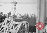 Image of a crane unloading military equipment Bordeaux France, 1918, second 6 stock footage video 65675048400