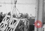 Image of a crane unloading military equipment Bordeaux France, 1918, second 9 stock footage video 65675048400
